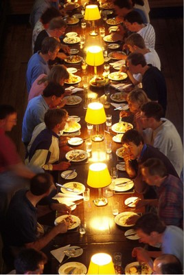 Students sitting at a long table for a college dinner